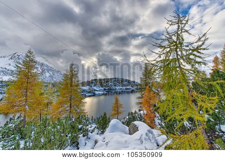 Alpine Lake In Autumn With The First Snow