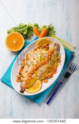 sole fish with carrots celery and orange sauce