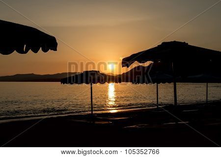 Silhouette Of A Beach Umbrella At Sunset On The Island Of Rhodes