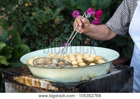 Woman Cooking Delicious  Loukoumades Pastry