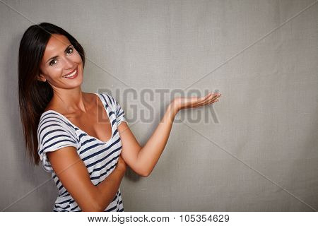 Good-looking Girl Standing Against Grey Background