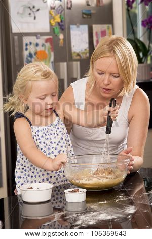 Child With Mother Whisking