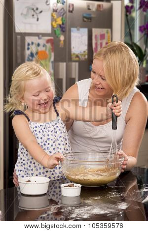 Mother And Daughter Whisking