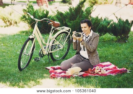 Young Woman With Bicycle At The Picnic In The Park