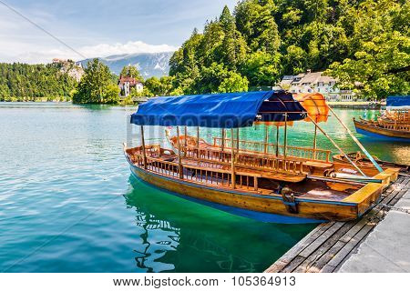 Wooden Tourist Boat On Shore Of Bled Lake, Slovenia