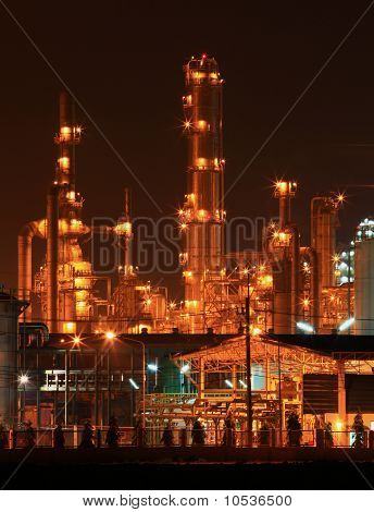 closeup of petrochemical oil refinery factory pipeline at night
