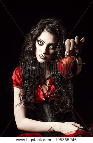 Strange Scary Girl With Mouth Sewn Shut Holds Apple Studded With Nails