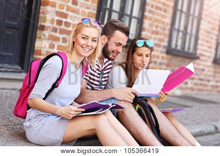 A picture of a group of students sitting in the campus
