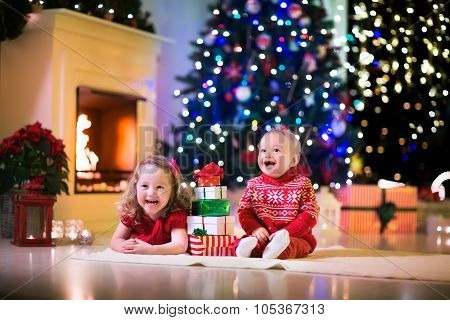 Kids Playing At Fireplace On Christmas Eve