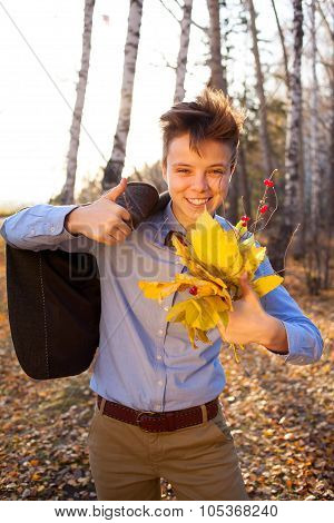 Guy Holding Bouquet Of Autumn Leaves