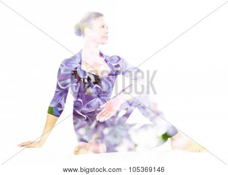 Double exposure portrait of young woman performing yoga asana, combined with photograph of flowers