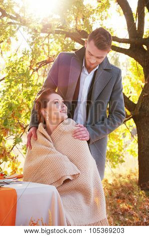 Bride And Groom At The Wedding Table. Autumn Outdoor Setting.