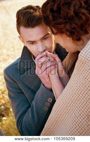 Young Man Trying To Warm His Girlfriend's Hands