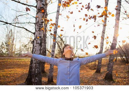 Happy Hipster Playing With Autumn Leaves