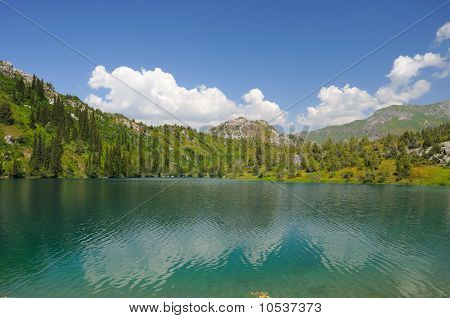 Colorful lake, mountains, sky and clouds