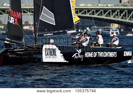 ST. PETERSBURG, RUSSIA - AUGUST 22, 2015: Catamaran of Team Turx from Turkey during 3rd day of St. Petersburg stage of Extreme Sailing Series. The Wave, Muscat team of Oman leading after 2 days