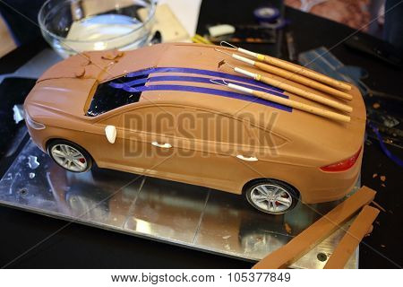 RUSSIA, MOSCOW -?? 4 DEC, 2014: Ford car model made of clay with tools on the roof.