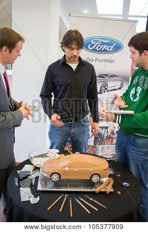 RUSSIA, MOSCOW -?? 4 DEC, 2014: Men talk about the car Ford, made of clay.