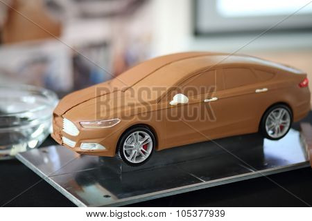 RUSSIA, MOSCOW -?? 4 DEC, 2014: Miniature car on the table at press event for Ford in SREDA loft.