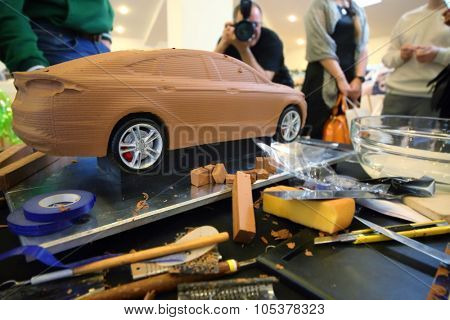 RUSSIA, MOSCOW -?? 4 DEC, 2014: Pieces of clay and modeling tools on the table at the press event for Ford in SREDA loft.