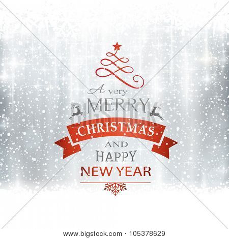 Abstract silver winter, Christmas card with snowflakes, snowfall, out of of focus light dots, stars and light effects and the wording Merry Christmas and Happy New Year. Copy space
