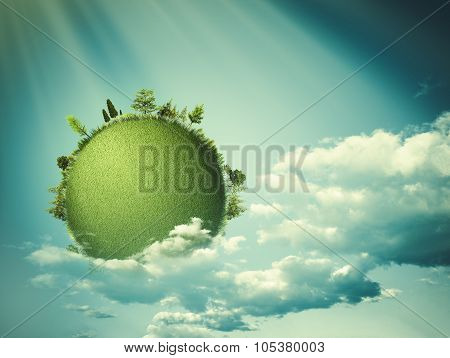 Green planet floating in the clouds