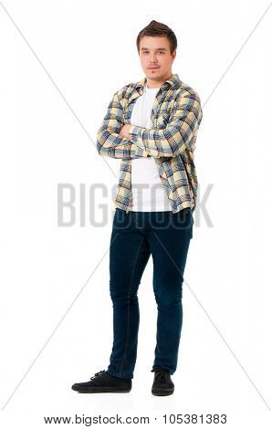 Full length portrait of a confident young man on isolated white background with arms crossed