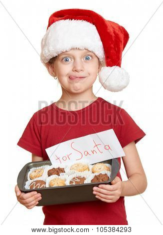 girl in santa hat with cookies lick oneself - winter holiday christmas concept