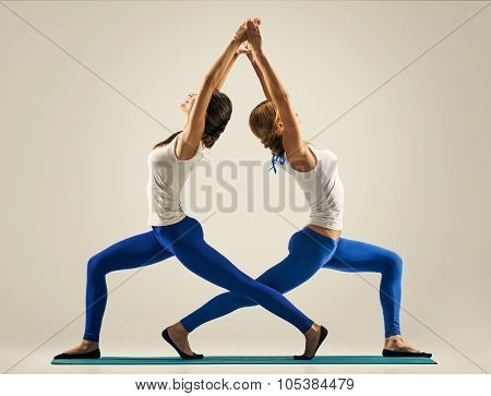 yoga in pair. stretching back. standing