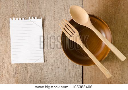 Blank Note Paper With Wooden Spoon On Tabletop