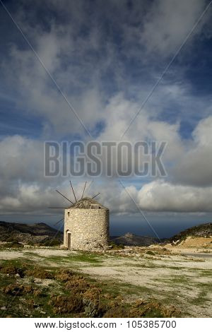 Windmill by a nice summer day in Naxos, Greece