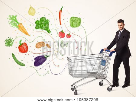Businessman pushing a shopping cart and healthy vegetables coming out of it
