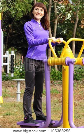 Woman Exercising Upper And Lower Body On Outdoor Gym, Healthy Lifestyle