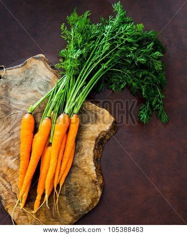 Bunch Of Fresh Raw Orange Carrots With Green Leaves