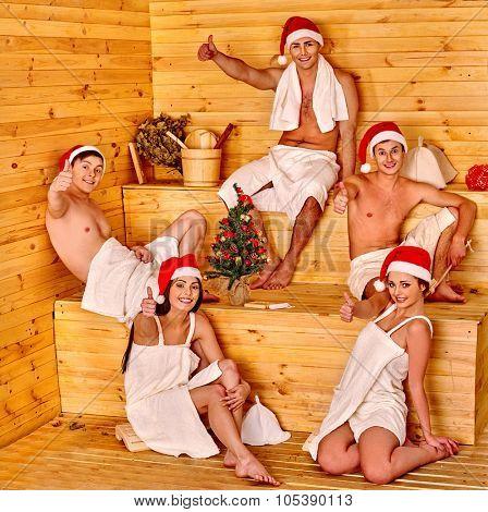 Group people in Santa hat  celebrate Christmas at sauna.