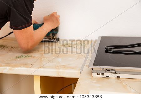 Installing New Hob In Modern Kitchen