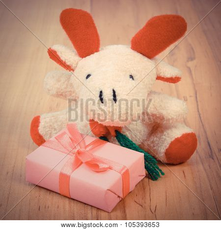 Vintage Photo, Plush Reindeer With Gift For Christmas Or Other Celebration