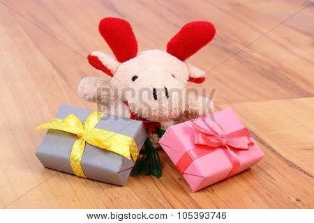 Plush Reindeer With Colorful Gifts For Christmas Or Other Celebration