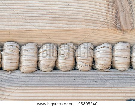 Closeup of wooden cabin wall with hemp rope sealant