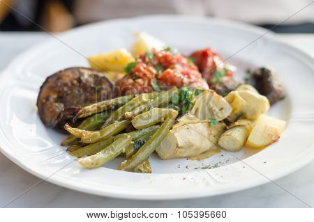Vegetable Plate Of Marinated Green Beans And Bell Peppers, Fried Artichokes And Potatoes