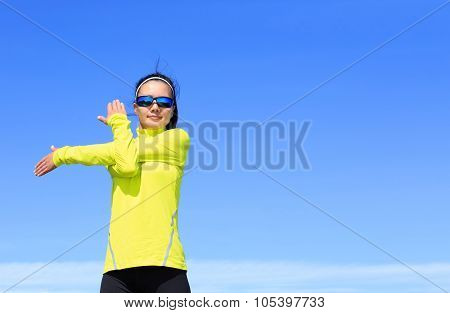 Young Fitness Woman Runner Stretching Arms Before Running On Beautiful Mountain Peak