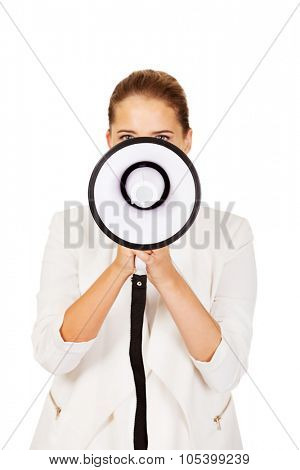 Young blonde businesswoman holding megaphone.