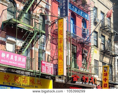 NEW YORK,USA - AUGUST 15,2015 : Colorful buildings with chinese signs at Chinatown in New York City