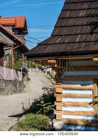 LANCKORONA, POLAND - OCTOBER 4 2015: Rural road with wooden cottages in historical village Lanckorona located in the Southern part of Poland