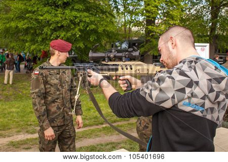 KRAKOW, POLAND - MAY 3, 2015: Unidentified people during demonstration of the military and rescue equipment during annual Polish national and public holiday the Constitution Day May 3rd.