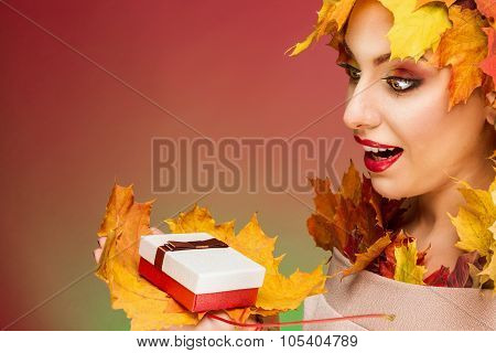Woman excited looking at gift