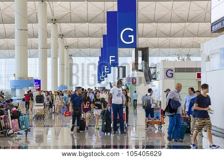 Travellers in the departure hall of an airport