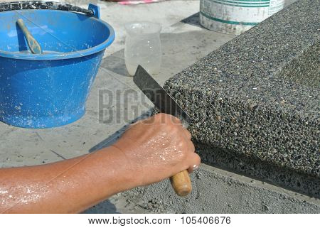 Pebble wash works by construction workers