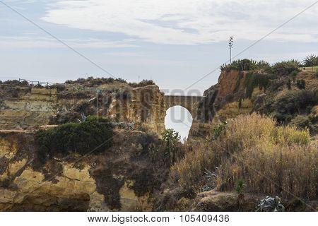 landscape bridge among the rocks near the beach Praia do Camilo in Lagos in Portugal