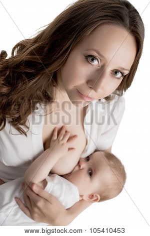 Portrait of pretty mother feeding breast her baby